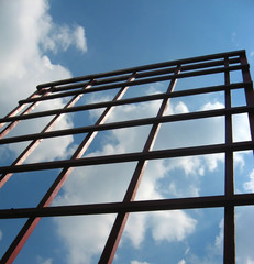 garden trellis with square sections on a sunny day