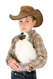 A rural boy carrying a silkie chicken in his arms.   poster