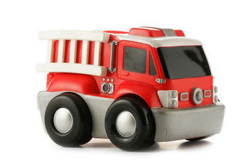 Red fire engine toy isolated over a white background