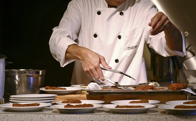 A chef preparing food.