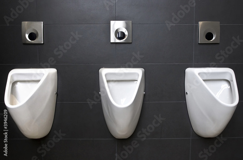 3 urinals on slate