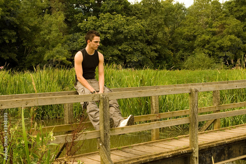 Man sitting on a Bridge