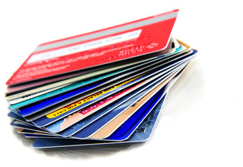 Stack of colorful credit cards with small reflection