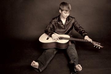 boy explores the guitar