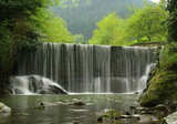 A scenic waterfall stream in silky effect. poster