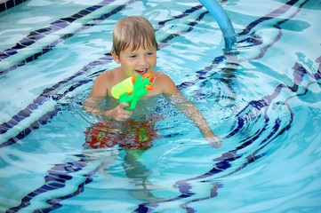 Child Squirting Water Gun