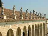 Statues above Villa Manin porch poster