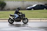 Fototapety motard sous la pluie