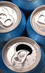 Top view of aluminum beverage cans with one open