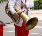 Musician in the street with a brass instrument poster