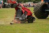 car pulled apart by monster truck poster