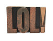 the term 'LOL in old letterpress wood letters