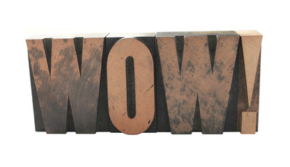 the word 'WOW' in old letterpress wood letters