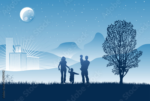 Silhouettes of family on a background of night skyscrapers