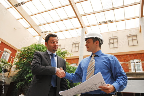 business man and architect Shaking Hands