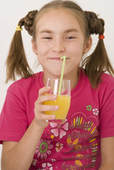 Girl drinking orange juice II