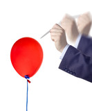 Businessman about to burst a balloon poster