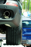 Exhaust pipe of the new automobile. poster