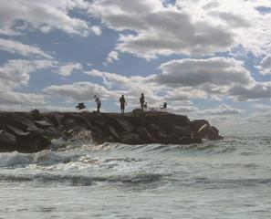 Fishermen on rock pier