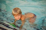 Child Wading in a Swimming Pool poster