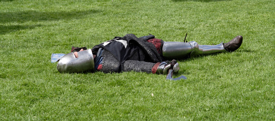 Knight playing dead after a mock battle