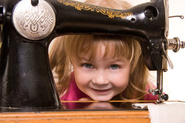 child at old sewing-machine