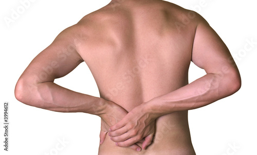 Rear view of a young male. Holding his back in pain.