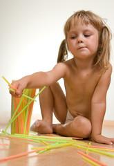 child with straws