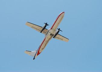 Turboprop airplane seen from below