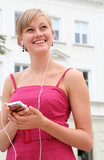 Woman holding an mp3 player poster