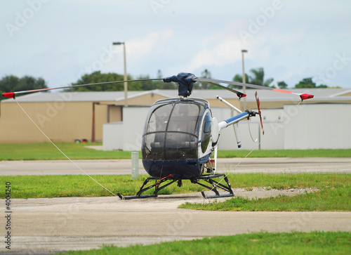 Small sightseeing helicopter on the ground