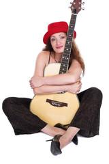 The woman embraces a guitar