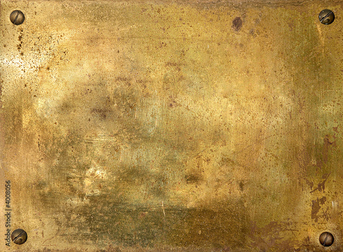 Shiny brass metal plate with screws