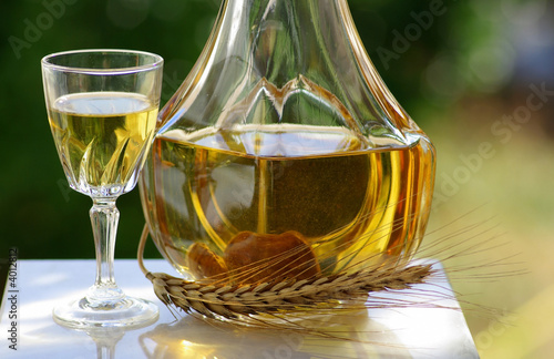 bottle and glass with burning hot water of fig.