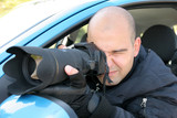 Professional photographer in action with telephoto lens poster