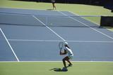 Woman tennis - returning a ball poster