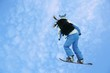 Flying snowboarder