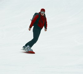 Snowboarder on snow slope