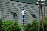 Repairman on ladder poster