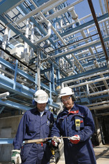 engineers inside oil refinery