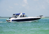 Powerboat at sea for leisurely outdoor weekend fun poster