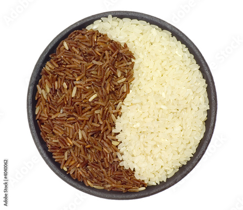 Bowl of brown and white rice forming a ying yang symbol
