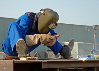 Welder At Work, Wearing The Correct Attire