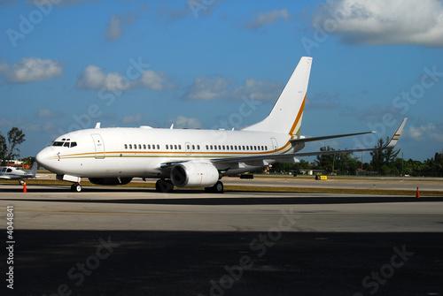 Poster Boeing 737 passenger jet parked at terminal