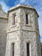historic old limestone prison tower