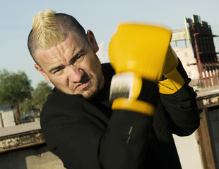 Punk Businessman with Boxing Gloves