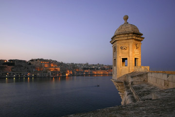 The Vedette at dusk in Senglea,Malta, with Valletta in the back