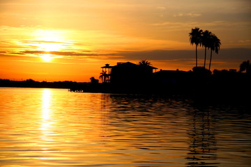 house on the water during sunset, florida 3