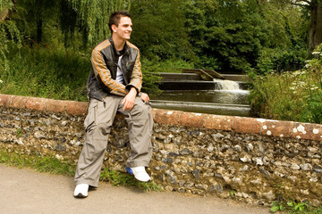 Young man on bridge in countryside