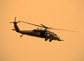 American military helicopter at sunset